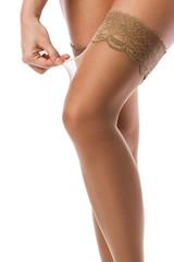 Female legs in nude stockings