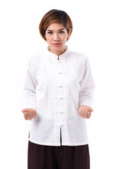 active, strong, confident asian woman practicing kungfu or tai chi quan, assuming stance