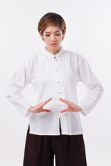peaceful, strong, confident asian woman practice kungfu qigong, belly center dantian concentration