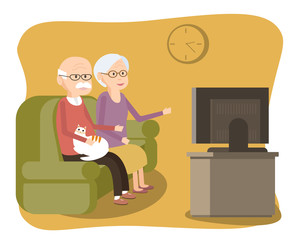 Elderly Couple Sitting on the Sofa and Watching TV