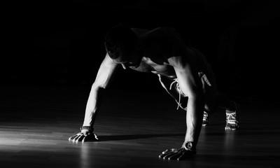 Man making burpees during strength training in gym. - fototapety na wymiar