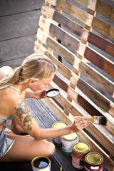 Woman applying glaze on pallet