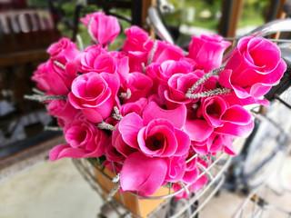 Fake pink flower on bicycle