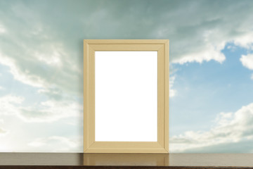 Blank photo frame with cloudy sky background