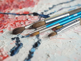 Paintbrushes on oil painting canvas