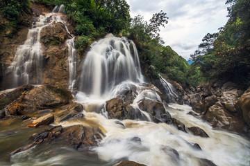 Large waterfall in the rainy season; The village Cat Cat brightn