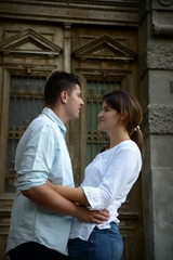 Couple siting in front of an old entrance