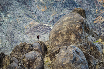 Climber standing on the peak of rocks mountain in Death Valley N