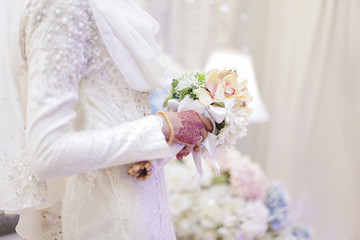 Bride with bouquet of flowers. Close up.