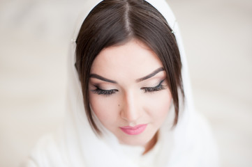 beautiful young girl in hijab closed her eyes