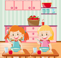 Two kids eating breakfast in kitchen