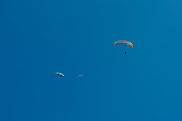 Paragliders in the dreamlike sky