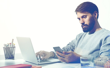 Bearded working businessman isolated
