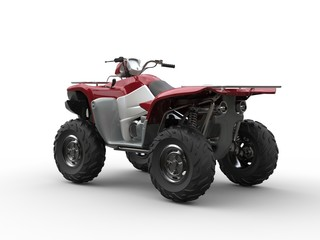 Dark red modern quad bike - focus on rear wheels