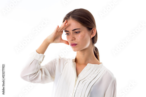 """""""Woman holding hand at her forehead"""" Stock photo and ..."""