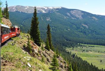 Train on a mountainside track