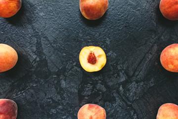 peaches on black background