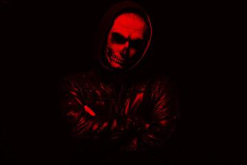Evil man on black background