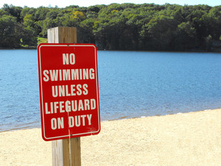 No swimming unless lifeguard on duty warning beach sign