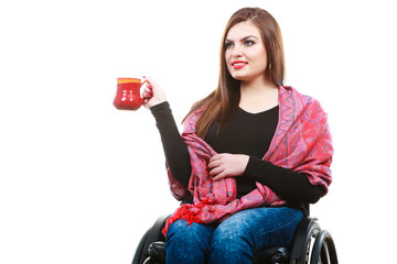Woman in wheelchair with mug
