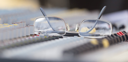 Concert music console with sunglasses