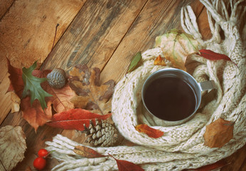 cup of coffee and knitted scarf
