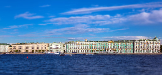Tilt and shift view of historical Neva riverside in Saint Petersburg in summer and cloudy blue sky
