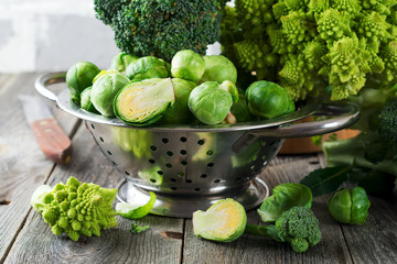 Assortment of raw cabbages on old wood background