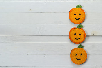 Halloween background with decorative pumpkins on white wooden bo