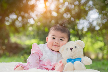 happy smiling cute little girl child outdoors in summer day