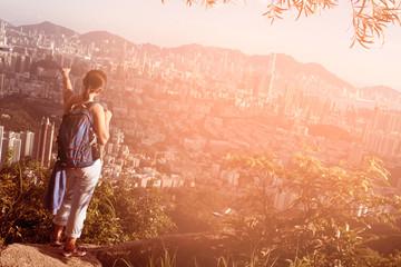 woman hiker enjoy the view at sunset mountain lion rock peak cli