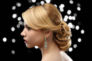 Fashion model girl with nice hairdo on dark shiny background