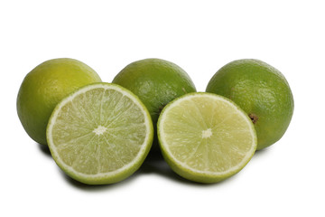 Green lemon fruits on a white background