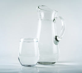 Jug and glass on white background