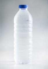 Wet plastic water bottles isolated on white background