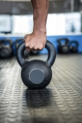 Cropped hand holding kettlebell