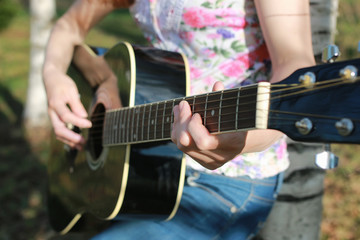 guitar string woman hand outdoor
