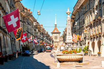 Street view on Kramgasse with fountain and clock tower in the old town of Bern city. It is a popular shopping street and medieval city centre of Bern, Switzerland Wall mural