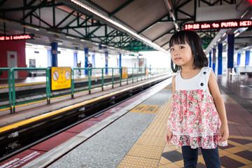 Asian Chinese Little Girls Waiting for Light Rapid Transit
