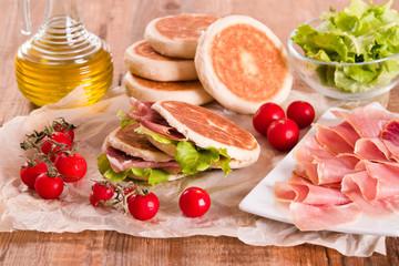 Tigella bread stuffed with ham and lettuce.