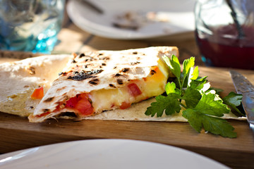 roll pita with cheese and tomatoes