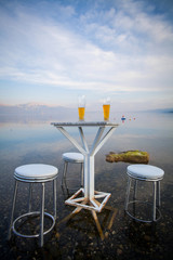 Table and chairs, by the lake