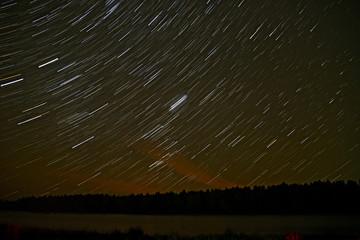 star tracks sky forest river