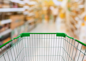 Shopping cart with Supermarket Aisle with product on Shelves