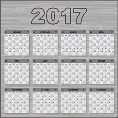 calendar 2017 year. paper sheet on wooden boards. Week starts with Sunday. Vector image.