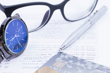 Finance Concepts, pen, watch, credit card and glasses with passb