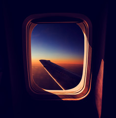 View from Airplane Window at Sunset