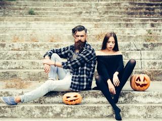 halloween couple with pumpkin