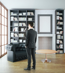Businessman in luxurious library