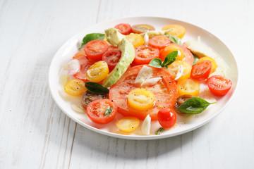 Tomato, avocado and red onion salad